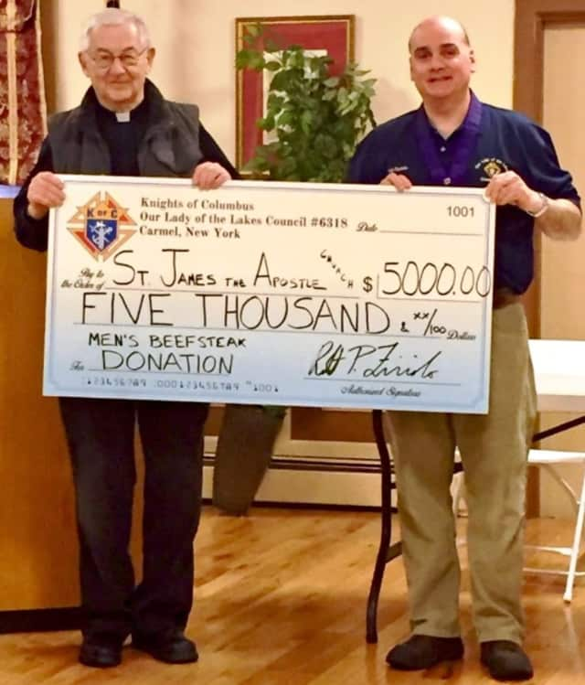 The Carmel Knights of Columbus presented a $5,000 donation to St. James the Apostle Church for capital improvements.
