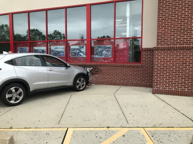 A driver lost control and drove into the side of a Norwalk CVS store.