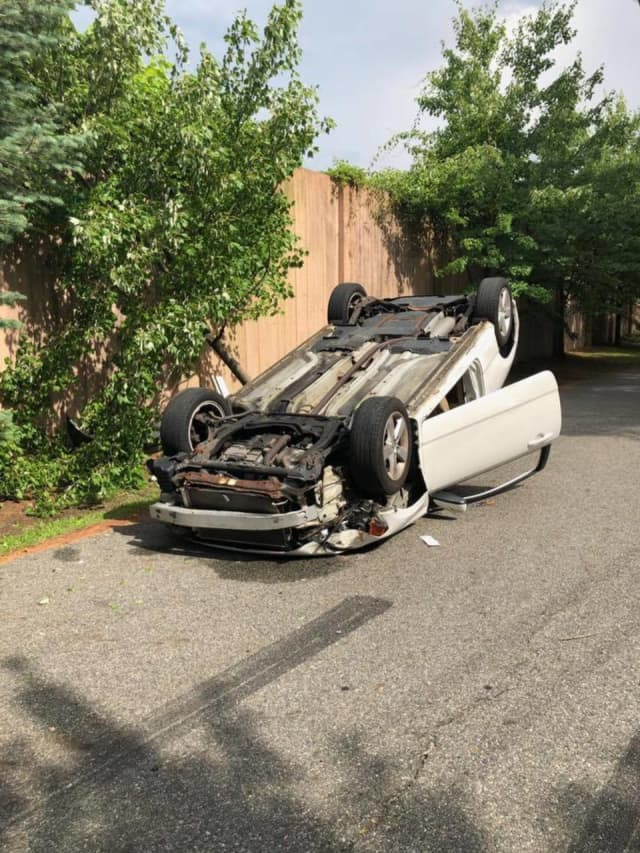 A car overturned in Hillburn as a driver attempted to reach her cellphone after dropping it inside the vehicle.