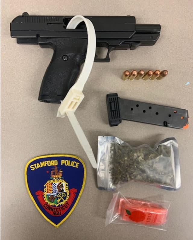 The gun and pot seized during the stop.