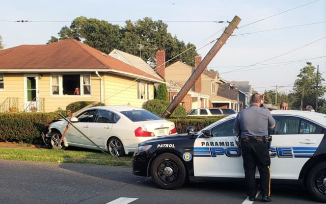 The fleeing suspects' sedan toppled a utility pole in Fair Lawn.