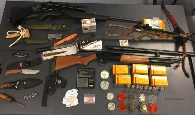 The guns and weapons seized.