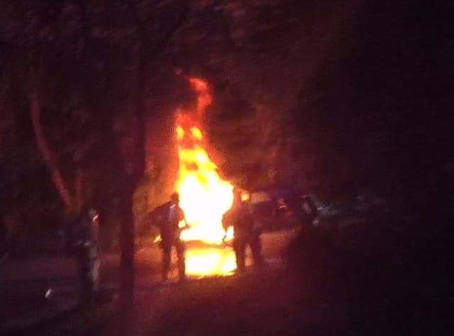 A driver who had crashed was saved from his burning vehicle by two Good Samaritans.