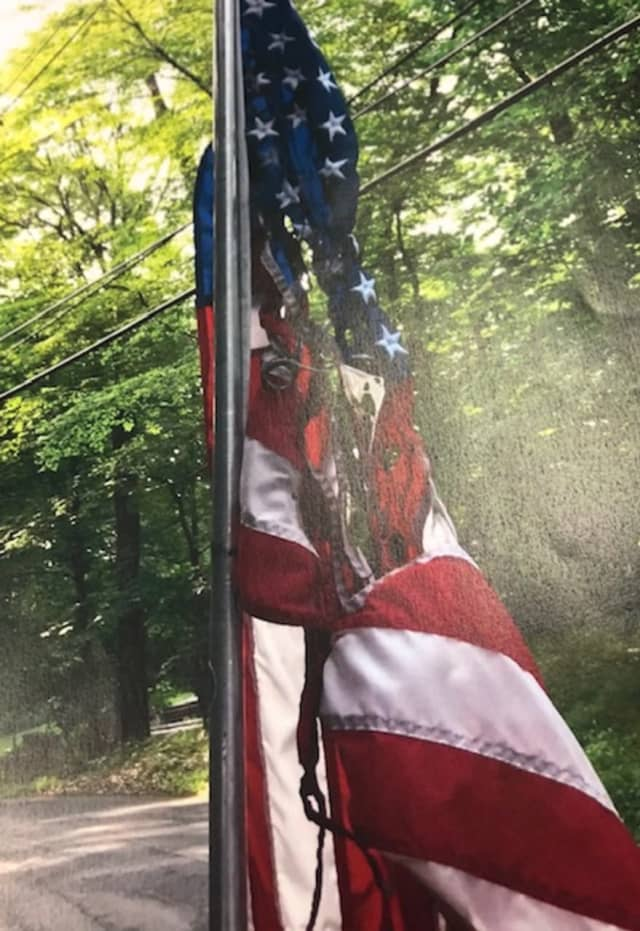 Police in Ridgefield are searching for suspects that burned American flags and damaged mailboxes.