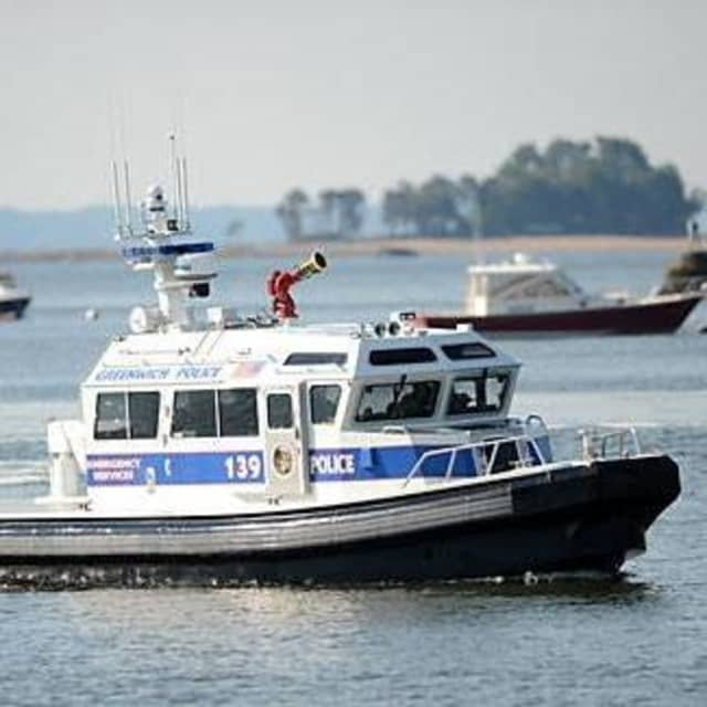 Greenwich Police rescued a man who had fallen aboard in Long Island Sound.