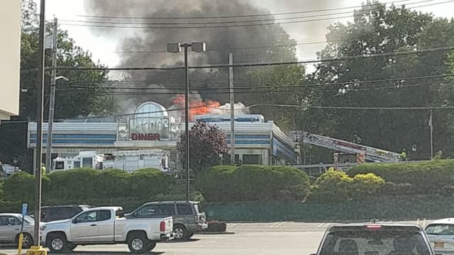 A fire is ripping through the popular Landmark Diner.