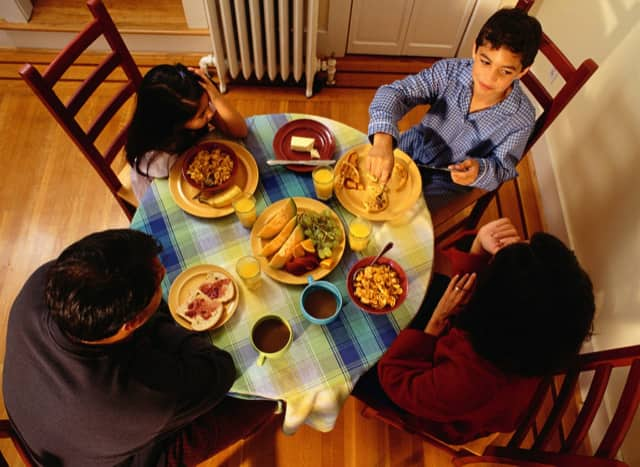 Experts at Newport Academy say that regularly eating family dinners can help lower rates of depression in children.
