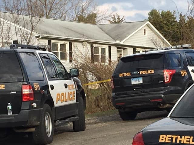 Police arriving at a murder-suicide at 11 Governors Lane in Bethel on Good Friday could hear a gunshot on the 911 call as they were arriving on the scene.