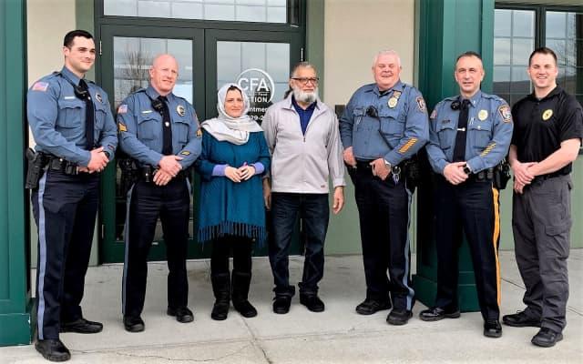 (l. to r.) Officer Christopher Monico, Sgt. Brendan Mullin, Bushra and Babar Khawaja, Officer Robert Loveman, Lt. Phillip Tangel and Detective Eric Larsen