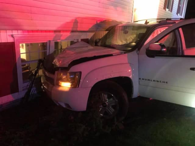 A pickup truck slammed into a home in Monroe.