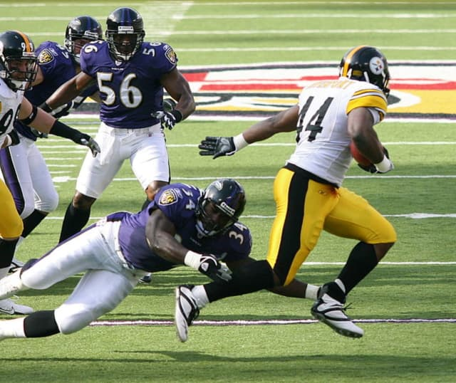 Baltimore Ravens pursuing Pittsburgh's Najeh Davenport of the Pittsburgh Steelers in a 2006 NFL game.