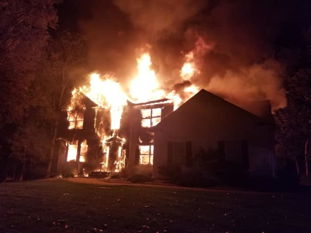 The parents and their two small boys made it out of the Lenore Court house, but lost nearly everything in the blaze.
