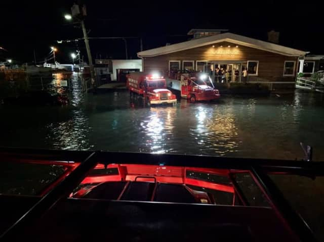A large military-style vehicle was used by the Bay Shore Fire Department to rescue some 50 patrons and employees from a flooded restaurant.