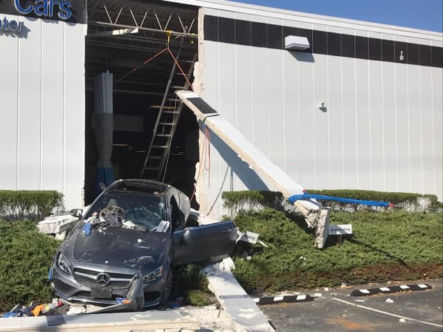 A driver hit the gas instead of the brakes and crashed through a business.