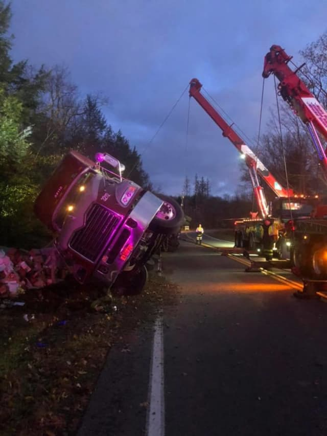 A tractor-trailer carrying eggs ran off the road and overturned.