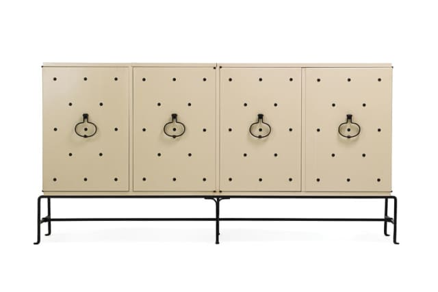 Lacquered and studded cabinet with wrought iron fittings, 1960s, sold for $27,500.