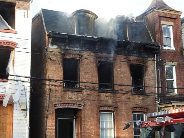 City of Newburgh police rescued a man stranded on the roof a burning building and another was rescued from inside.