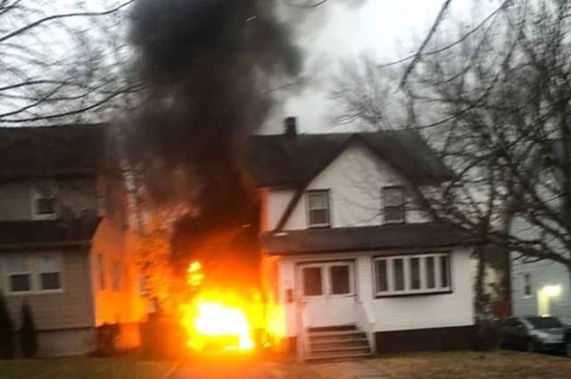 The Tilden Avenue car fire in Teaneck spread to a house. No injuries were reported.