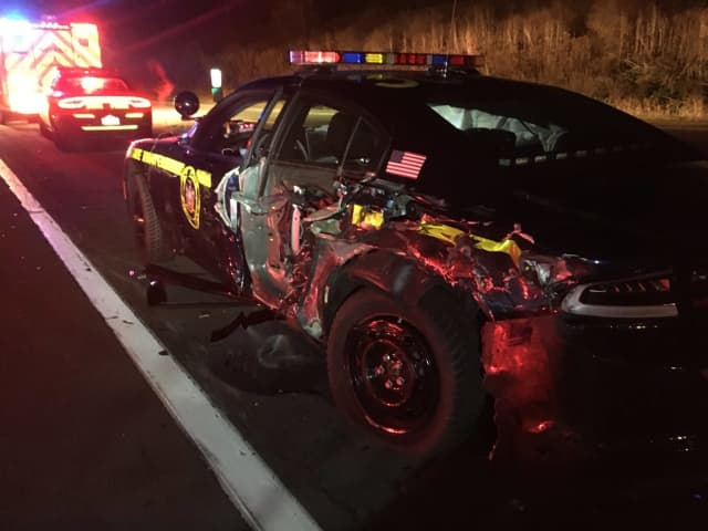 State Police are reminding the public of the 'Move Over' law after a trooper's vehicle was hit by a tractor-trailer.