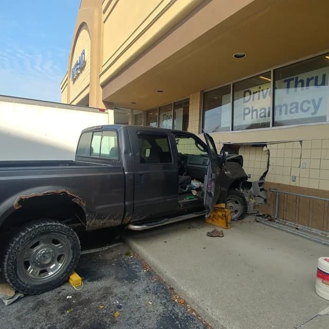 A man was charged was allegedly driving high in drugs when he plowed into a local pharmacy, police say.