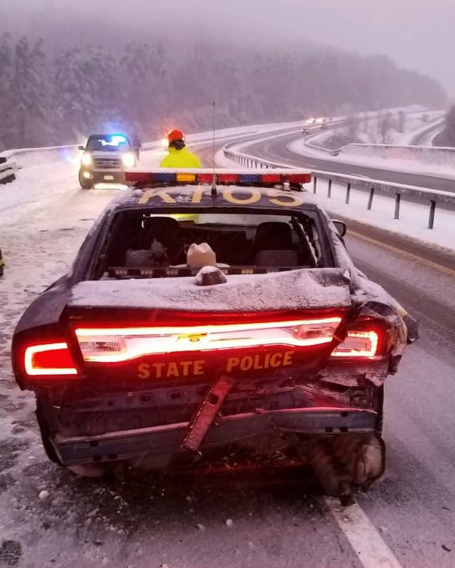 A New York State trooper escaped injury after his vehicle was rear-ended.