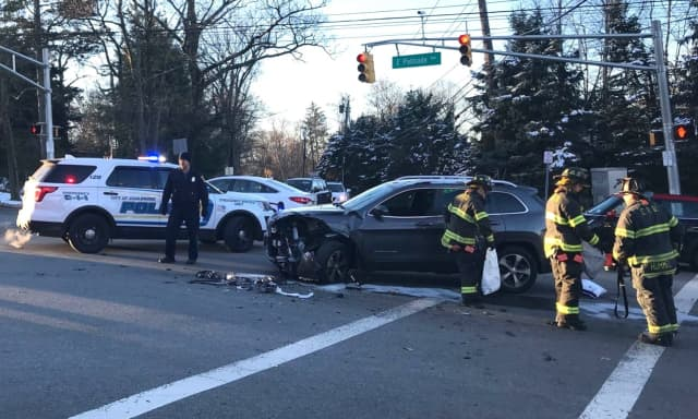 The vehicles collided on East Palisade Avenue at North Woodland Street in Englewood just before 8 a.m.