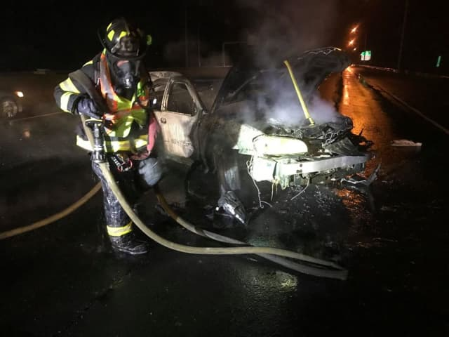 The driver of a car that caught fire on I-95 fled the scene.