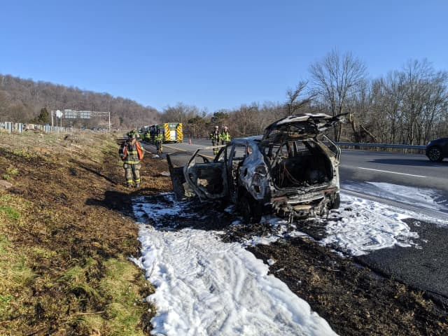 A car fire on 78 Sunday spread to the roadway and some nearby brush