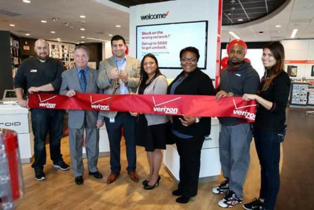 """Center for Safety & Change Executive Elizabeth Santiago joined Rockland County Executive Ed Day at the ribbon-cutting ceremony for the new Verizon Wireless """"Smart Store"""" at The Shops at Nanuet."""