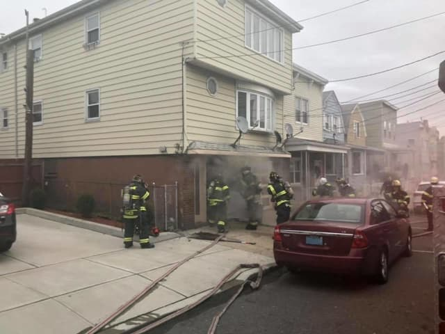 Firefighters battled a blaze at 9 New Street Friday morning.