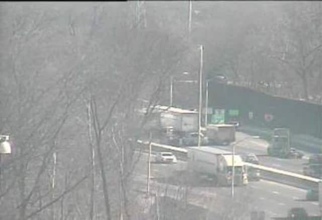 Traffic is slow on I-95 through Darien after a rollover crash.