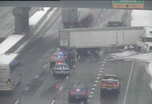 A jackknifed tractor-trailer blocks two lanes of I-95 southbound near Exit 15 for Stuart Avenue in Norwalk on Tuesday afternoon. The highway appears wet but not snowy as a storm rocks the area.