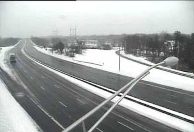 I-95 is largely empty — and wet but clear of snow — on Tuesday afternoon as a snowstorm begins to taper off. The state travel ban will be lifted at 5 p.m.