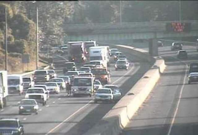 A crash blocks the left lane of I-95 near Exit 19 on Tuesday morning.