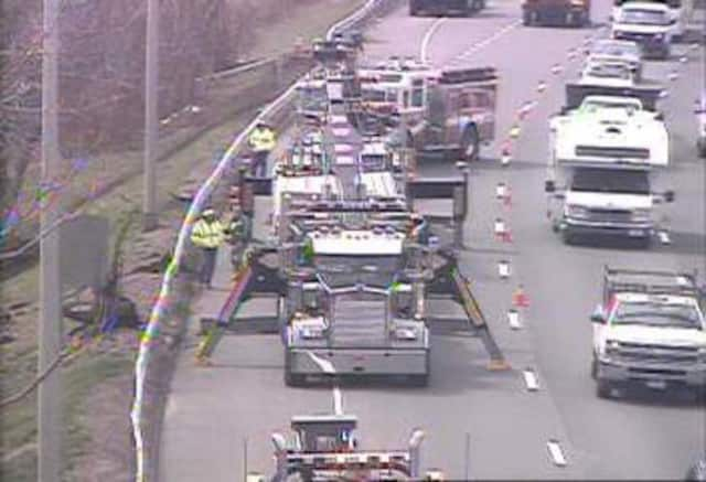 Heavy equipment is at the scene of a tractor-trailer crash on northbound I-95 in Fairfield on Friday.