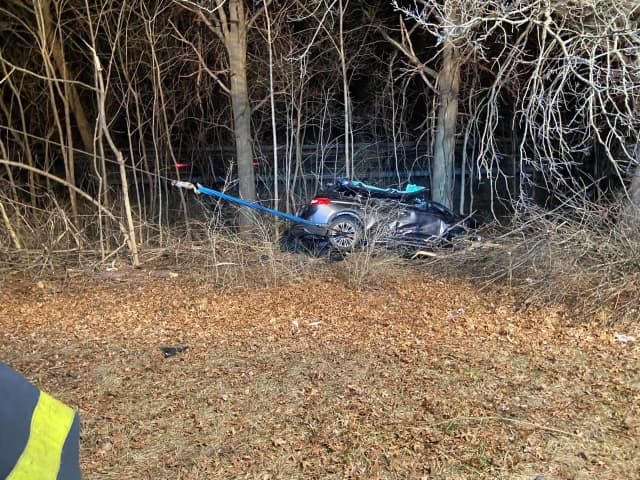 Two people were trapped in a single-vehicle crash in Bedford.