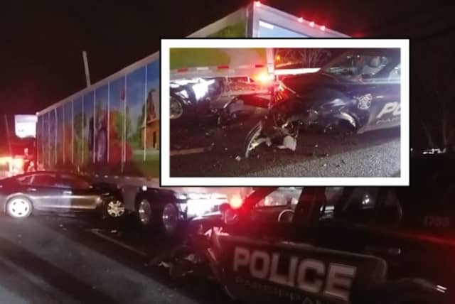 The officer was pulled over on Route 10 Wednesday to help a disabled Wegmans tractor-trailer when he was slammed from behind by a Nissan Altima, authorities said.