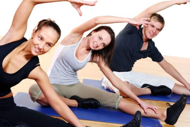 Summer yoga classes take place at the Ramsey Library on Thursdays.