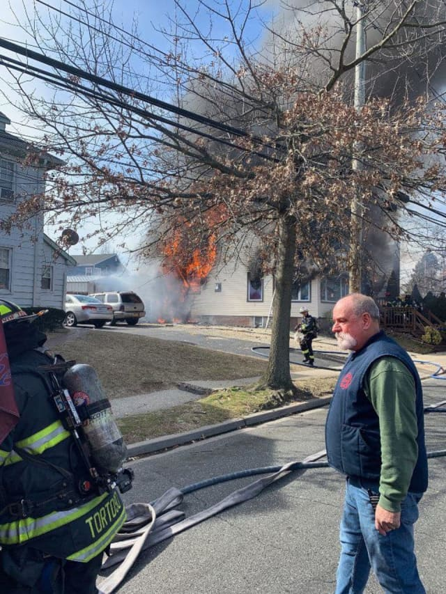 Firefighters are battling a four-alarm fire in Farmingdale.