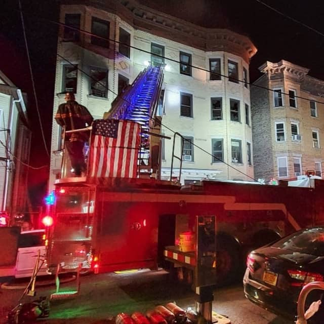 Yonkers firefighters on the scene of the fatal four-alarm fire.