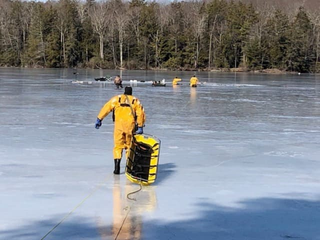 Torrington firefighters rescued six people who had fallen through the ice on a pond.