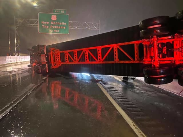 The tractor-trailer blocked all three lanes of traffic on I-95.