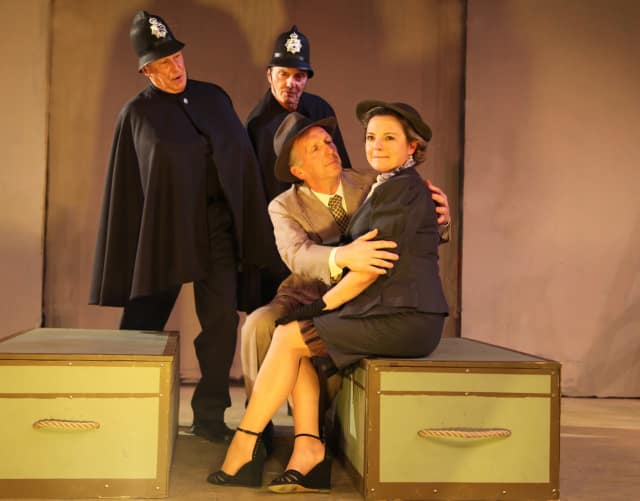 "Bill Johnston, Richard Holmes, David Victor and Samantha Pattinson in the Westport Community Theatre production of ""The 39 Steps."""
