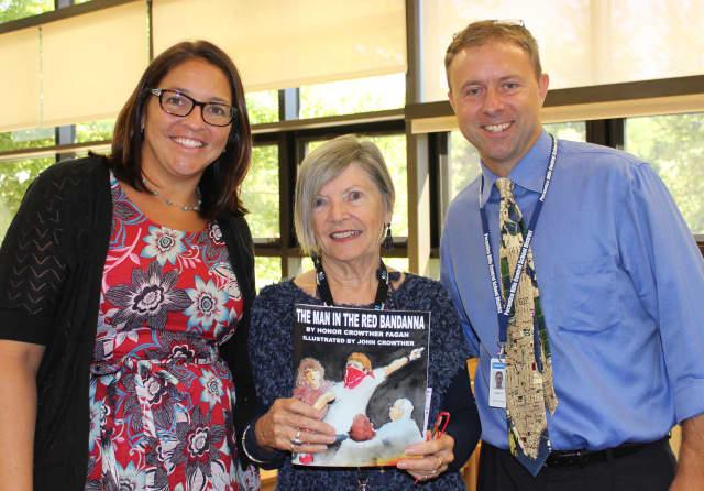 Social studies teacher Laura Garrido (l.) with Interim Principal Adam Brown and museum docent Marjorie Vincent.