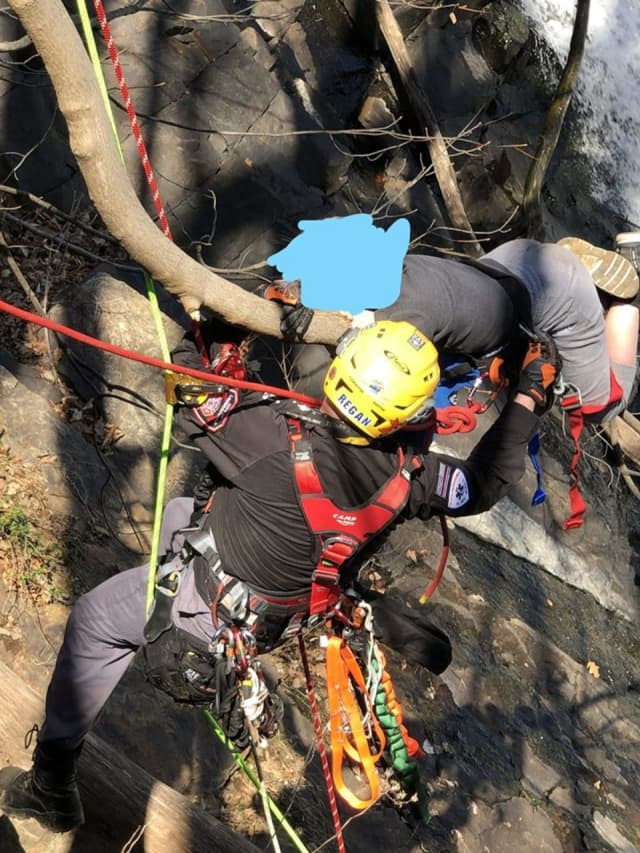 The teen -- who was not injured but couldn't move -- was on a branch of a tree sticking out of the side of a cliff approximately 50 or 60 feet above the water at the base of the dam.