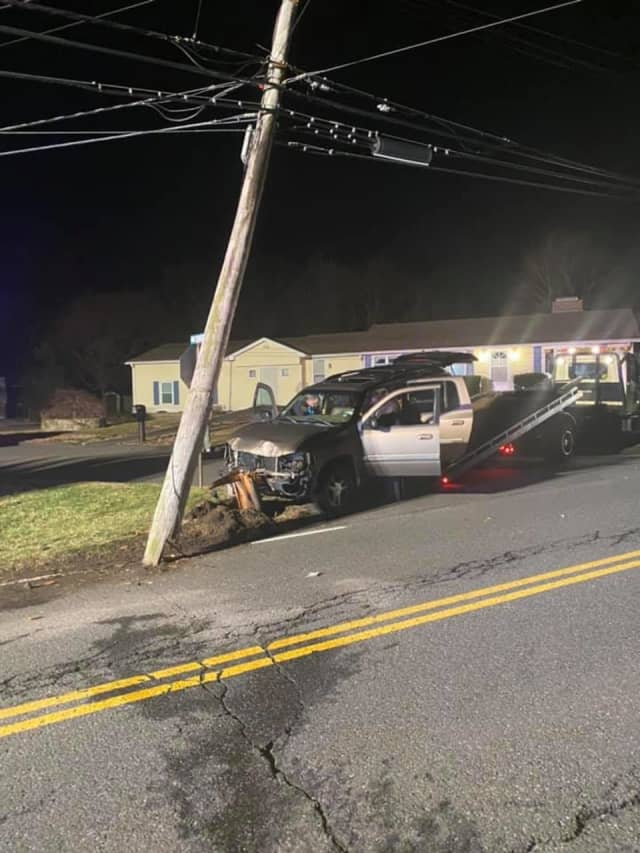 Two utility poles were damaged during a single-vehicle crash in Trumbull.