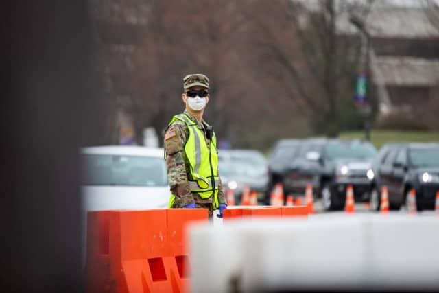At member of the NJ National Guard directs traffic at the BCC testing site in Paramus.