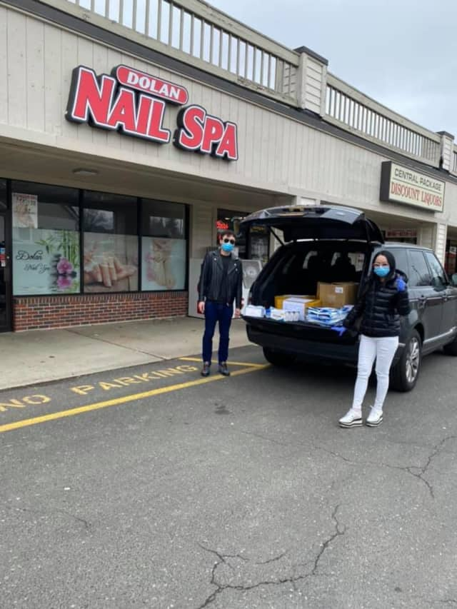 Tiffany and Lucas from Dolan Nail Spa loading up the supplies to donate.