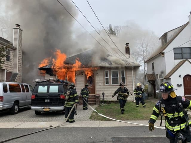 A man was forcibly removed from his home after setting it on fire and barricading all the doorways.
