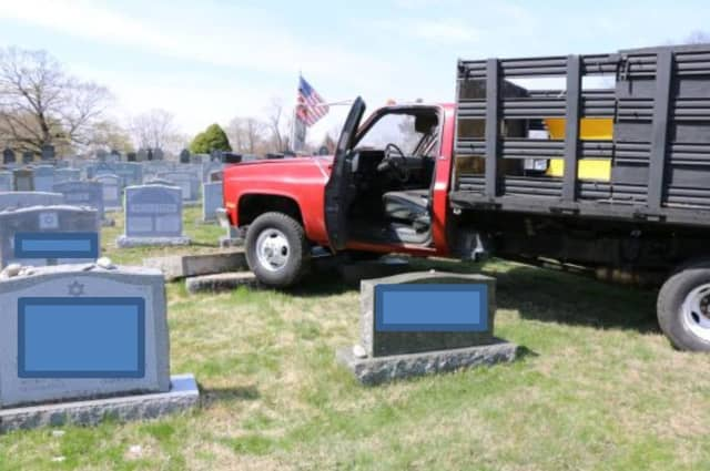 Two juveniles allegedly crashed a vehicle in an area cemetery causing extensive damage to the grounds and headstones.